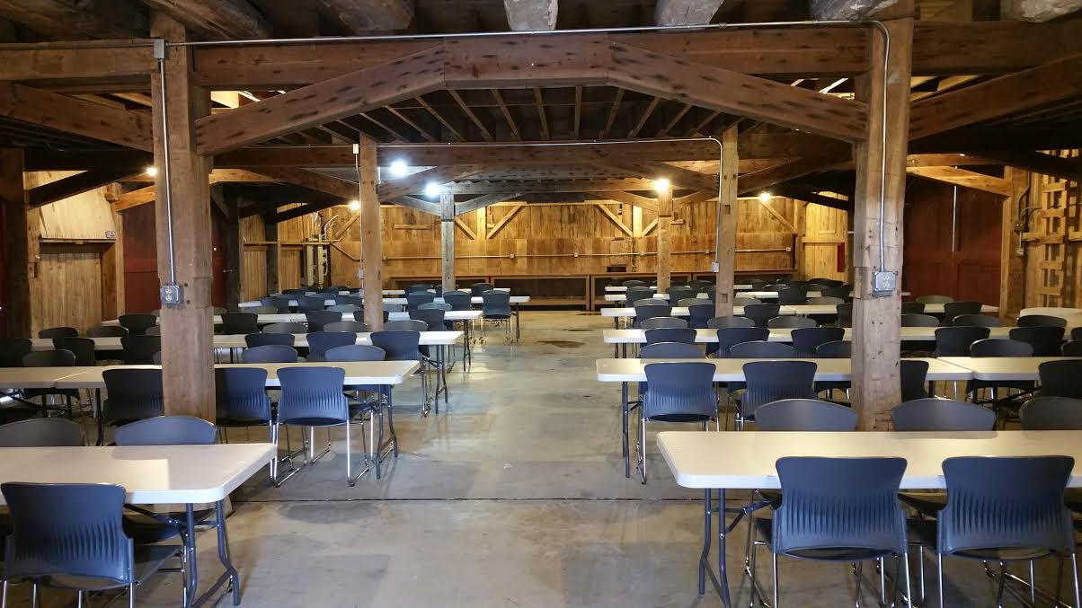 inside Whites Star Barn with tables and chairs set-up